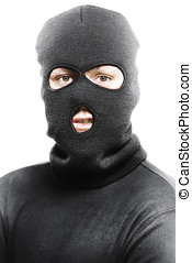 Face of a burglar wearing a ski mask or balaclava - Face of...