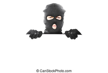 Thief with robbery mask holding blank white board with room...