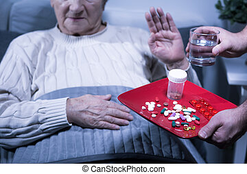 Patient refuse medicines - Image of old hospital patient...