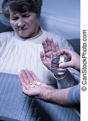 Senior ill woman refuse treatment - Image of senior ill...