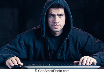 Young cyber warior in hoody - Photo of young cyber warior in...