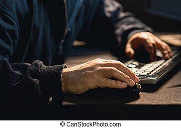 Hacker typing on pc keyboard
