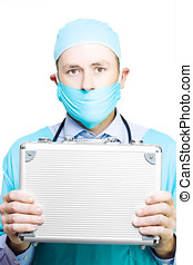 Doctor holding a metal first aid kit - Doctor in mask and...