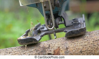Cutting Wood with Power Jigsaw - Closeup shot of a power...