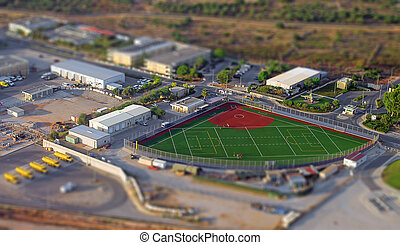 Aerial view of compact baseball and football field