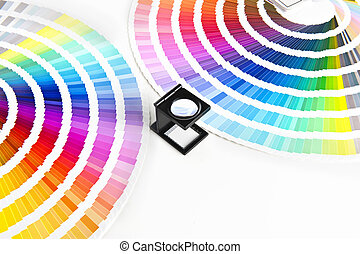 color charts - Two Color charts and a magnifying glass...