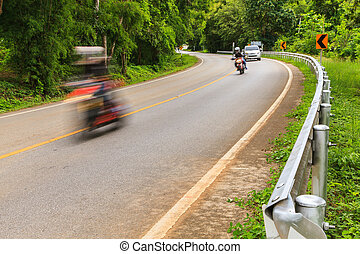 Motorcycle - Motion blur of Motorcycle on Winding Road