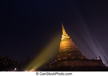 Ancient buddhist temple ruins at night in Sukhothai...