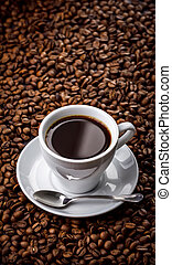 Cup with fragrant coffee drink on beans background - Hot...