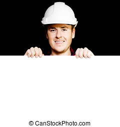 Craftsman in hard hat holding up blank sign