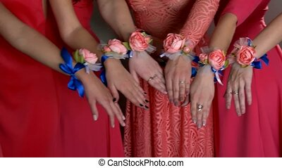 Girl show hands in pink dress close-up of a group of flowers