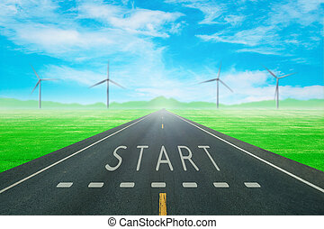 road through the green field with sign start on asphalt -...