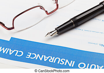 auto insurance claim form with fountain pen