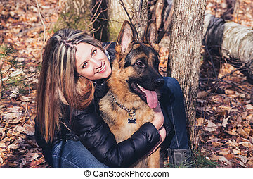 young woman and dog - Young woman smiling with a german...