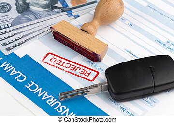 auto insurance claim form with dollar and car key
