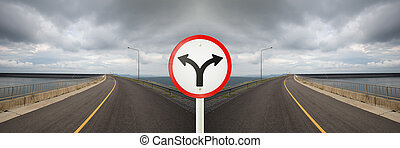 fork junction sign with crossroads spliting in two way -...