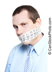 Silent businessman showing measured restraint with a tape...