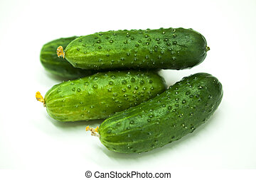 Fresh appetizing tasty cucumbers on a white background. -...