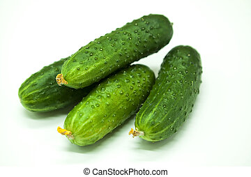 Fresh appetizing tasty cucumbers on a white background -...