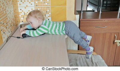 Little boy with laptop lying on the table, HD