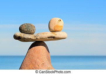 Stones in equilibrium - Black and white stones in balance at...