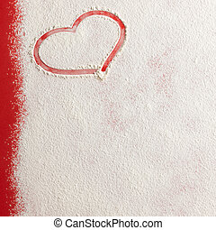 Valentine love red heart shape in snow on red background.