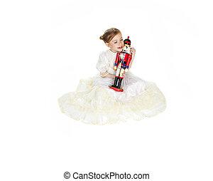 Ballerina who holding a nutcracker - A Beauty Ballerina who...
