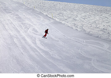 Ski slope and snowboarder at cold day Georgia, region...