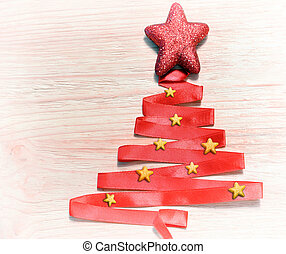 Abstract christmas tree made from red ribbon and star