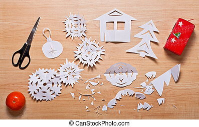 Paper decoration, candle, mandarin and scissors on the...