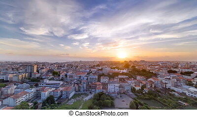 Rooftops of Porto's old town on a warm spring day timelapse sunset, Porto, Portugal