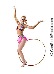 Attractive young gymnast posing with hoop