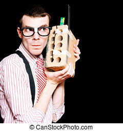Male Nerd Inventor Holding Brick Mobile Telephone - Smart...