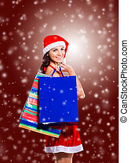 girl with shopping - beautiful girl in costume of Santa...