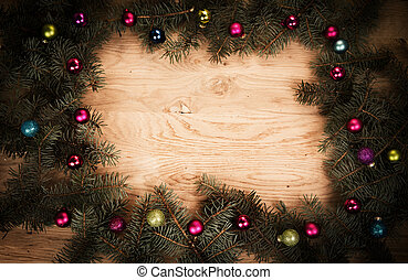 green fir branches on the wooden floor with darkening at the...