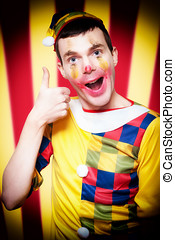 Smiling Circus Clown Standing Inside Bigtop Tent - Playful...