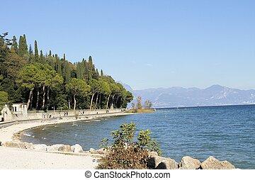 Sirmione - landscape of the beach in Sirmione on Garda lake...