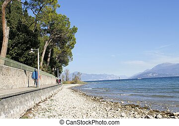 Sirmione - landscape of the beach in Sirmione on Garda lake...