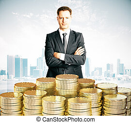Businessman with piles of coins at city background