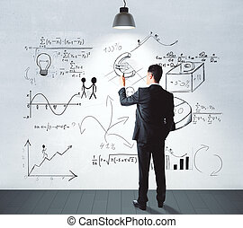 Businessman drawing business idea concept on white wall in empty room