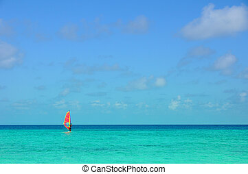 Windsurfing - Picture of a Windsurfing at sea at maldives.