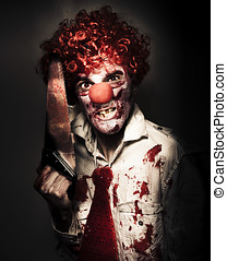 Angry Horror Clown Holding Butcher Saw In Darkness -...