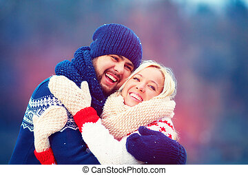happy couple having fun during winter holiday