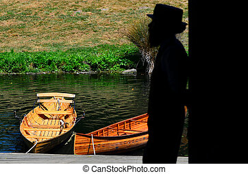 Punting sailor on the Avon river Christchurch - New Zealand...