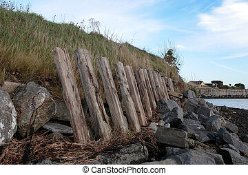 erosion protection posts and rocks - the sea barrier to...