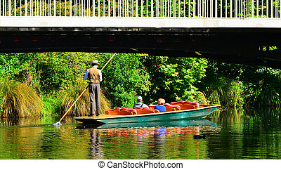 Punting on the Avon river Christchurch - New Zealand -...