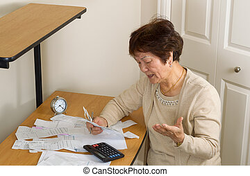 Older woman frustrated by all her financial bills