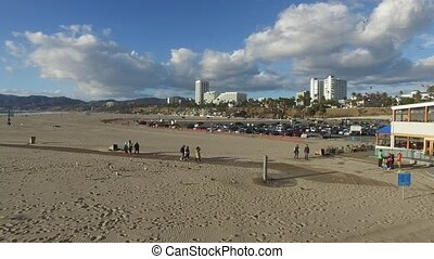 People flock to the beach on a hot day HD