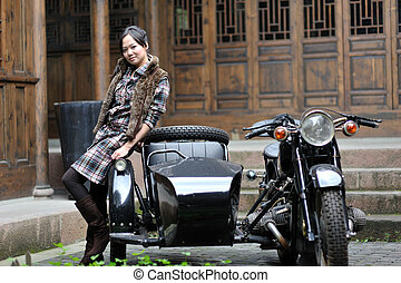 Women by motorcycle