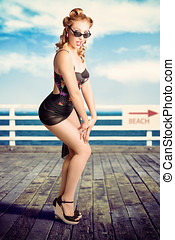 Cute Pinup Girl Looking Surprised On Beach Pier - Picture...
